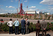 View of the 2012 Olympic site in East London. This area has become a focus for people gathering to see the site and for tour groups. Some of the new facilities will be reused in their Olympic form, while others, including the 80,000 seater main stadium will be reduced in size for use as a football staduim. The plans are part of the regeneration of Stratford in east London which will be the site of the Olympic Park, and of the neighbouring Lower Lea Valley.