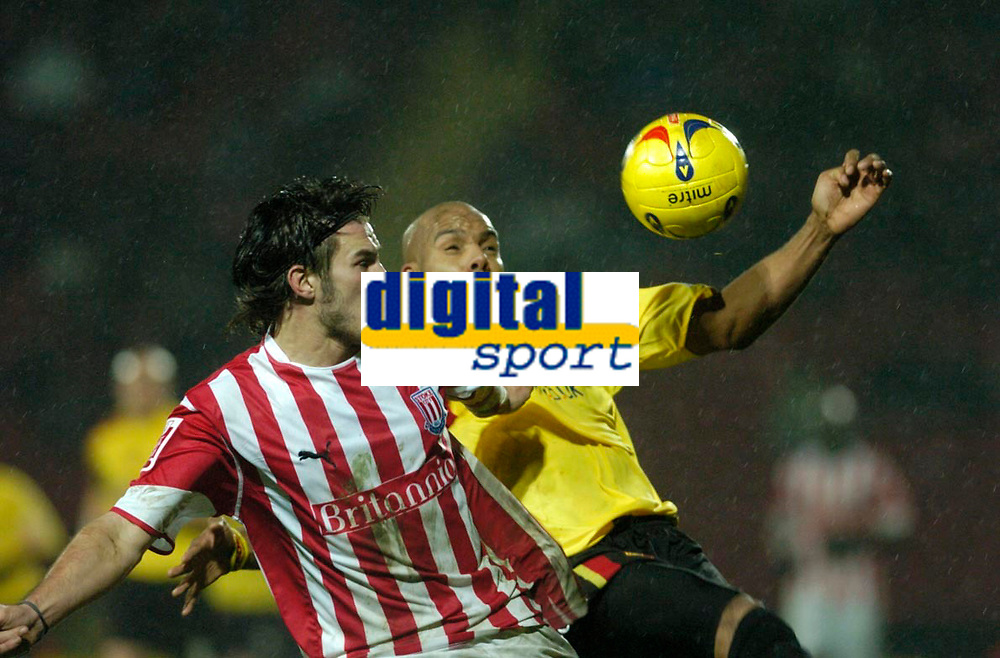 Photo: Leigh Quinnell.<br /> Watford v Stoke City. Coca Cola Championship.<br /> 14/01/2006. Stokes Carl Hoefkens and Watfords Marlon King attack the same goal.