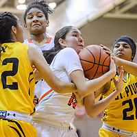 Gallup Bengal Camille Etscitty (15) wrestles the ball away from St. Pius Sartan Gabriella Gallegos (20) Friday at Gallup High School.