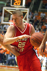 02 January 2004  Neil Plank makes a drive. Illinois State University ties up The Fightin Illini in regulation but fails to top the Big 10 team in overtime. Action took place at the Assembly Hall on the University of Illinois Campus in Champaign - Urbana Illinois.