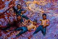Kids playing in water at Huranga Holi; Holi Festival, Dauji Temple, Badeo (near Mathura), Uttar Pradesh, India.