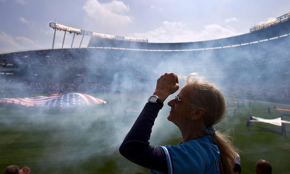 Diane Lines of Kansas City, Mo. tried to keep her hair out of her face during the National Anthem at the Kansas City Royals home opener against the Detroit Tigers at Kauffman Stadium. Lines was at her first ever Royals home opener.