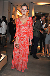 BRYONY DANIELS at a party as part of the Vogue Fashion's Night Out held at Tod's, 2-5 Bond Street, London on 6th September 2012.