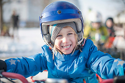 Close-up of girl riding quadbike