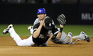 CHICAGO - JUNE 26:  Gordon Beckham #15 of the Chicago White Sox reacts after turning a game ending double play over the sliding Tyler Colvin #21 of the Chicago Cubs on June 26, 2010 at U.S. Cellular Field in Chicago, Illinois.  The White Sox defeated the Cubs 3-2.  (Photo by Ron Vesely)