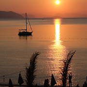 Morning in Aegean sea, boat and sunrise, Marmaris, Turkey