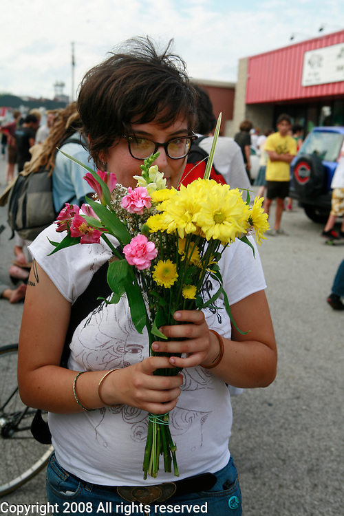 Emmalee of Rosa holds flowers she was given after playing a show during the Plan-It-X Festival.