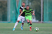 Forest Green Rovers Liam Noble(8) shields the ball during the Pre-Season Friendly match between SC Farense and Forest Green Rovers at Estadio Municipal de Albufeira, Albufeira, Portugal on 25 July 2017. Photo by Shane Healey.