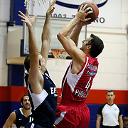 Efes Pilsen's Igor RAKOCEVIC (L) during their friendly basketball match Efes Pilsen between Olympiacos at Efes Pilsen Arena in Istanbul, Turkey, Sunday, October 03, 2010. Photo by TURKPIX