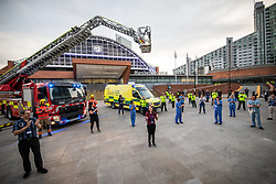 "© Licensed to London News Pictures. 23/04/2020. Manchester, UK. Emergency services show support for carers at a "" Clap for our Carers "" event outside the Nightingale NW Hospital in Manchester . The National Health Service has built a 648 bed field hospital for the treatment of Covid-19 patients , at the historical railway station terminus which now forms the main hall of the Manchester Central Convention Centre . The facility treats patients from across the North West of England , providing them with general medical care and oxygen therapy after discharge from Intensive Care Units . Photo credit: Joel Goodman/LNP"