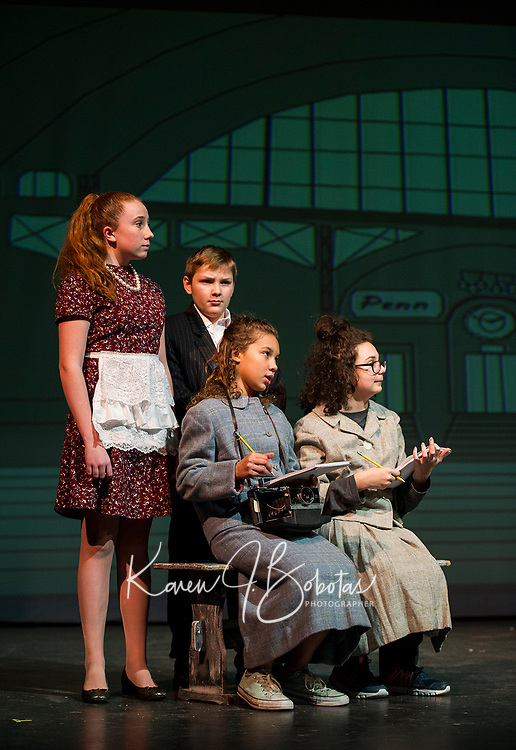 Newspaper reporters Ellie Nichols and Mischa Gregory take notes during a press conference during dress rehearsal for Bye Bye Birdie with Gilford Middle School on Tuesday afternoon.  (Karen Bobotas/for the Laconia Daily Sun)