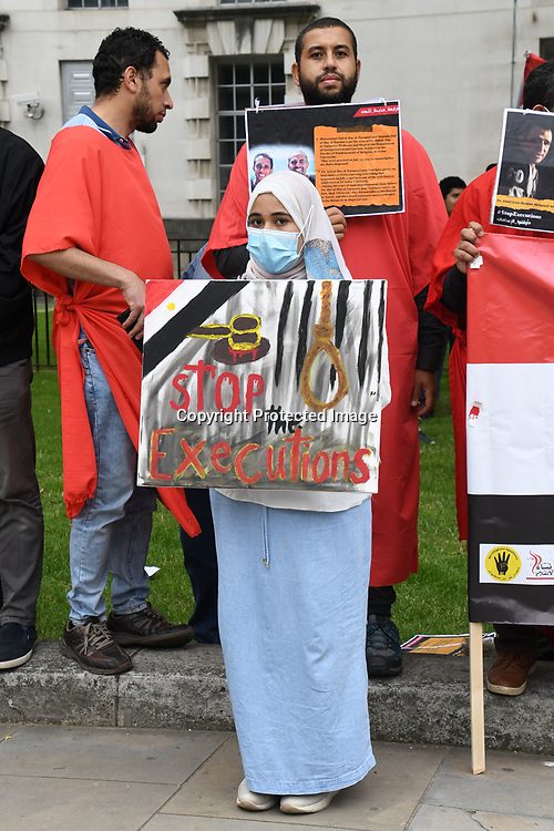 The unshamed support of the British Government for the authoritarian regime of General Sisi of Egypt. Protestors maka a gallows hanging people with an estimated 60,000 political dissidents languishing in prison, among whom are women & children outside Downing Street on 3rd July 2021, London, UK..