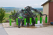 A very big vineyard tractor equipped for spraying treatments on eight 8 rows of vines simultaneously at the experimental vineyard of the CIVC at Plumecoq near Chouilly in the Cote des Blancs It is used for testing clones soil treatment vine treatments spraying, Champagne, Marne, Ardennes, France