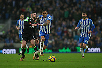 Football - 2017 / 2018 Premier League - Brighton and Hove Albion vs. AFC Bournemouth<br /> <br /> Anthony Knockaert of Brighton skips over the challenge of Bournemouth's Lewis Cook at The Amex Stadium Brighton <br /> <br /> COLORSPORT/SHAUN BOGGUST