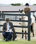 Martin Nee studying the form  at the 93rd annual Connemara Pony show in Clifden Co. Galway  Photo:Andrew Downes, XPOSURE <br />   Photo: Andrew Downes, Xposure.