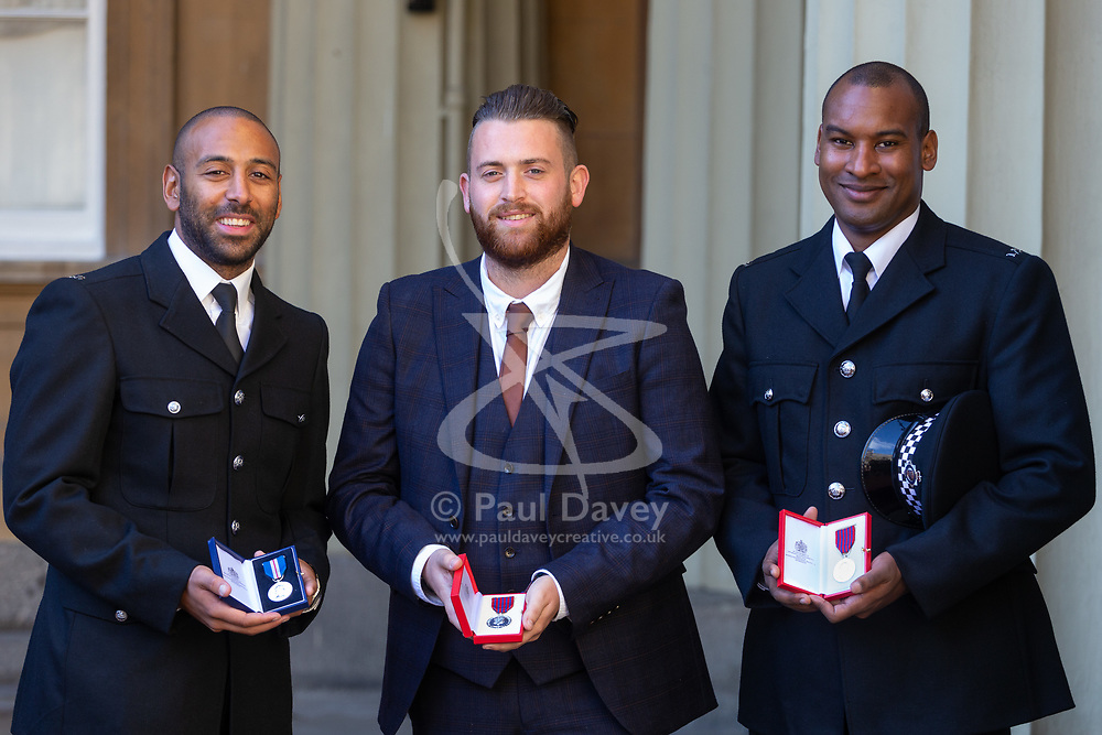 London Bridge Terror attack heroes, left to right, Constable Leon McLeod (Queen's Gallantry Medal), Met Police  Constable Charles Guenigault (George Medal) and BTP Constable Wayne Marques (George Medal) display their awards at an investiture by Her Majesty The Queen at Buckingham Palace in London. London, October 11 2018.