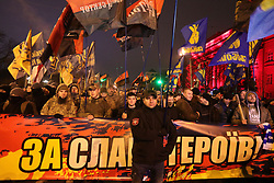 January 1, 2018 - Kyiv, Ukraine - Participants of a torchlight procession marking 109 years since the birth of OUN leader Stepan Bandera carry a banner, flags and burning torches along a central street, Kyiv, capital of Ukraine, January 1, 2018. Ukrinform...KYIV. Members of the public have marked the 109th birthday anniversary of Stepan Bandera, the leader of the Organisation of Ukrainian Nationalists (OUN). Traditionally, they marched along the central streets lighting their way with torches. (Credit Image: © Yevhen Liubimov/Ukrinform via ZUMA Wire)