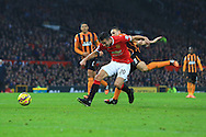 Robin van Persie of Manchester United struggles to get a shot away as he is impeded by Hull's James Chester - Manchester United vs. Hull City - Barclay's Premier League - Old Trafford - Manchester - 29/11/2014 Pic Philip Oldham/Sportimage