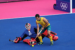 Erasmus Pieterse of South Africa battles with Jamie Dwyer of Australia during the men's Hockey match between Australia and South Africa held at the Riverbank Stadium in the Olympic Park in London as part of the London 2012 Olympics on the 30th July 2012.Photo by Ron Gaunt/SPORTZPICS