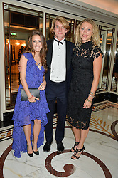 Left to right, GEORGINA LAMB, FREDDIE HUNT and EMILY LAMB at the David Shepherd Wildlife Foundation Wildlife Ball at The Dorchester, Park Lane, London on 9th October 2015.