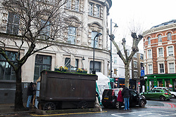 London, UK. 20 December, 2019. A view of Syd's Coffee Stall, which has been run by three generations of the same family on the corner of Shoreditch High Street and Calvert Avenue since 1919, a few minutes before it closed for business. The mahogany coffee stall, part of east London's history, will go on display in the new Museum of London in Smithfield in 2024.