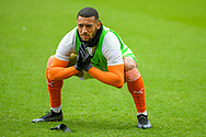 Blackpool forward Keshi Anderson (8) stretches off before the EFL Sky Bet League 1 match between Blackpool and Bristol Rovers at Bloomfield Road, Blackpool, England on 9 May 2021.
