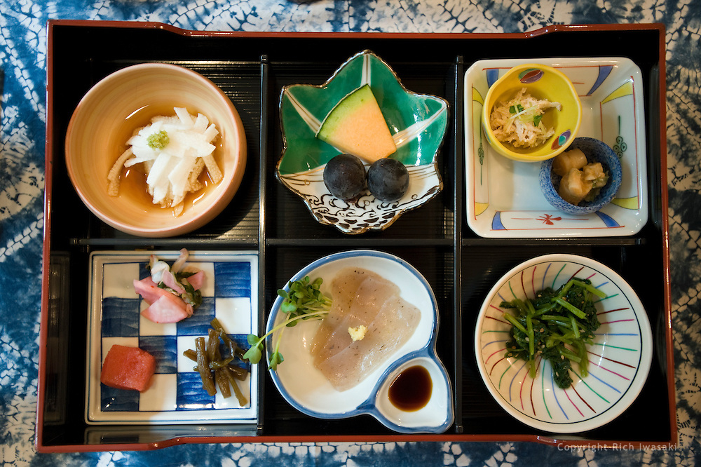 Overhead view of traditional breakfast food tray served to guests at Shinmei sansou, Gero Onsen, Gifu Prefecture, Japan