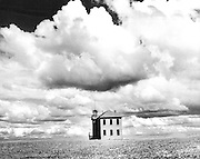 The Ralston School (Adams County) sits out its days in the midst of a wheatfield. Two stories and made of brick, it is sturdy enough to stand many years more. (Bruce McKim / The Seattle Times, 1987)