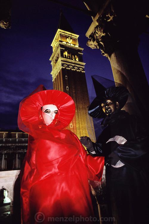Costumed revelers at Winter Carnival in Venice, Italy.