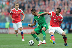 June 14, 2018 - Moscow, U.S. - MOSCOW, RUSSIA - JUNE 14: Midfielder Salem Aldawsari of Saudi Arabia and midfielder Alexander Samedov of Russia during a Group A 2018 FIFA World Cup soccer match between Russia and Saudi Arabia on June 14, 2018, at the Luzhniki Stadium in Moscow, Russia. (Photo by Anatoliy Medved/Icon Sportswire) (Credit Image: © Anatoliy Medved/Icon SMI via ZUMA Press)