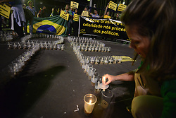 April 25, 2017 - SâO Paulo, São paulo, Brazil - Protesters opposed to corruption protested on Tuesday night (25) on Avenida Paulista, in São Paulo. Summoned by the Movement Comes Pra Street, the protest, entitled ''SOS STF-A Time of Justice,'' called for the creation of a task force to avoid the prescription of processes involving politicians, especially those cited in Odebrecht's privileged forum. Protesters also oppose the Abuse of Authority Act, which passes through the Senate. (Credit Image: © Cris Faga via ZUMA Wire)