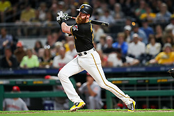 Jun 15, 2018; Pittsburgh, PA, USA; Pittsburgh Pirates third baseman Colin Moran (19) hits a single during the eighth inning against the Cincinnati Reds at PNC Park. Mandatory Credit: Ben Queen-USA TODAY Sports