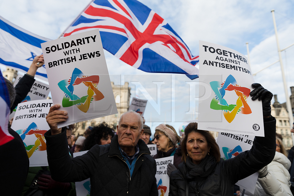 © Licensed to London News Pictures. 08/12/2019. London, UK. Jewish and non-Jewish supporters from the campaign groups 'Campaign Against Antisemitism' and 'Together Against Antisemitism' take part in a solidarity rally against antisemitism in public life and hate crime, held at Parliament Square in Westminster.  Photo credit: Vickie Flores/LNP