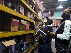 SOUTH AFRICA - Durban - 16 September 2020 - South African Police Service (SAPS) members along with KZN Liquor Authourity raided Panjivans liquor store in Umlazi, Durban looking for expired alcohol. In The picture is Captain Wiseman Thulani Mseleku.<br /> Picture: Motshwari Mofokeng/African News Agency (ANA)