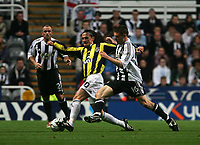 Photo: Andrew Unwin.<br /> Newcastle United v Fenerbahce. UEFA Cup. 19/10/2006.<br /> Newcastle's James Milner (R) looks to tackle Fenerbahce's Tuncay Sanli (C).