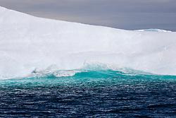Water Running Up On Massive Iceberg, Spert Island, Off Trinity Island, Antarctica