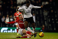 Jason McCarthy of Barnsley (L) tackles Ryan Sessegnon of Fulham (R). EFL Skybet championship match, Fulham v Barnsley at Craven Cottage in London on Saturday 23rd December 2017<br /> pic by Steffan Bowen, Andrew Orchard sports photography.