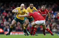 Australia's Stephen Moore hands off Wales' Gethin Jenkins during the Autumn International match at the Principality Stadium, Cardiff.