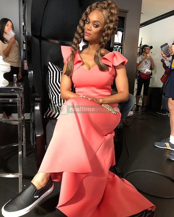 """Tyra Banks releases a photo on Instagram with the following caption: """"Eve\u2019s on set secret? Flats on her feet when the \ud83c\udfa5 camera is doing a close up just shooting her face! And dang that foot perspective makes Eve\u2019s foot look like she\u2019s the star of ATTACK OF THE 50 FOOT WOMAN! Ha!!! #LifeSize2 on Sunday!"""". Photo Credit: Instagram *** No USA Distribution *** For Editorial Use Only *** Not to be Published in Books or Photo Books ***  Please note: Fees charged by the agency are for the agency's services only, and do not, nor are they intended to, convey to the user any ownership of Copyright or License in the material. The agency does not claim any ownership including but not limited to Copyright or License in the attached material. By publishing this material you expressly agree to indemnify and to hold the agency and its directors, shareholders and employees harmless from any loss, claims, damages, demands, expenses (including legal fees), or any causes of action or allegation against the agency arising out of or connected in any way with publication of the material."""