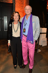 SIMON PARKER BOWLES and his wife CAROLYN at A Night of Reggae in aid of Save The Children held at The Roundhouse, Chalk Farm Road, London NW1 on 12th March 2014.