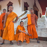 Four young monks posing in front of their monastery in Muang Ngoi Neua.