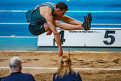 Owen Beuckens in action on long jump during the Dutch Athletics Championships on 13 February 2021 in Apeldoorn
