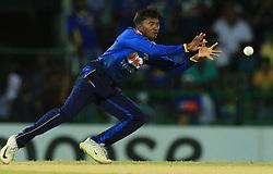 August 12, 2018 - Colombo, Sri Lanka - Sri Lankan cricketer Akila Dananjaya takes a catch during the 5th and final One Day International cricket match between Sri Lanka and South Africa  at R Premadasa International cricket ground, Colombo, Sri Lanka on Sunday 12 August 2018  (Credit Image: © Tharaka Basnayaka/NurPhoto via ZUMA Press)