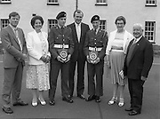 Army Apprentice Graduation Ceremony..1986..03.07.1986..07.03.1986..3rd July 1986..54 army apprentices graduated as tradesmen after completing three years of both military and technical training at the Army Apprentice School, Naas. The school is part of Devoy Military Barracks. The following trades are catered for: Radio Mechanic,Carpenter,Fitter, Electrician and Armourer..The newly graduated tradesmen will complete their basic military training at St Stephen's Barracks ,Kilkenny, for a further eight weeks..Mr John Witherington,Managing Director,Irish Shell, presented the awards...Photo of Mr John Witherington,Managing Director,Irish Shell, who presented the awards for best fitter to Shaun Nolan,Crockaun,Springhill,Co Laois (3rd from left) and the award for best armourer to Michael Kelly,Church Ave,Stradbally,Co Laois. included are proud parents,John and Margaret Nolan and Michael and Mary Kelly.