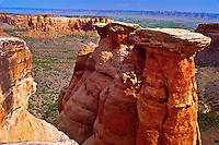 "Kayenta Formation or ""Caprock"" resting atop a Wingate Sandstone monolith in Monument Canyon. Colorado National Monument.  Colorado, USA."
