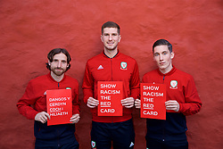 CARDIFF, WALES - Tuesday, October 9, 2018: Wales' L-R Joe Allen, Chris Mepham and Harry Wilson with Show Racism The Red Card signs after a media session at the St Fagans National Museum of History ahead of the International Friendly match between Wales and Spain. (Pic by David Rawcliffe/Propaganda)