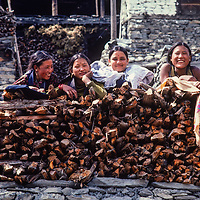 Young women laugh together in Manang village north of Annapurna in Nepal.