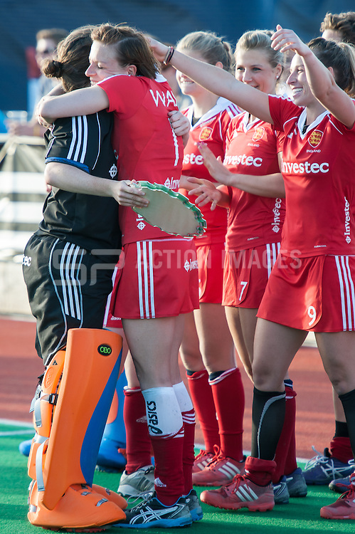 England's Maddie Hinch is congratulated by Captian Kate Walsh for winning Player of the Tournament during the during the Investec Hockey World League Semi Final 2013, London, UK on 30 June 2013. Photo: Simon Parker