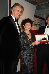 MARIA NIARCHOS and ARNAUD BAMBERGER MD of Cartier UK  at the 17th annual Cartier Racing Awards 2007 held at the Four Seasons Hotel, Hamilton Place, London on 14th November 2007.<br />