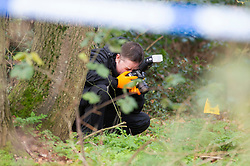 ©Licensed to London News Pictures 07/12/2019. <br /> Dartford,UK. Police forensic officer photographing evidence in the woods. A large police cordon is in place around woodland at Dartford Heath, Dartford,Kent. <br /> According to Local media Kent police are investigating the rape of a woman on Thursday 5th December. Police arrived at the scene yesterday afternoon (6th December).<br /> Photo credit: Grant Falvey/LNP